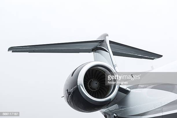 tail and turbine engine of private jet - jet engine stock photos and pictures