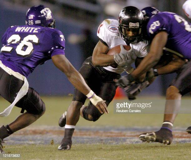 Tail back Garrett Wolfe of the NIU Huskies in a 37 to 7 loss to the TCU Horned Frogs in the San Diego County Credit Union Pointsettia Bowl on...