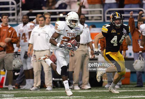 Tail back Jamaal Charles of the Texas Longhorns makes a 72 yard touchdown pass against Mike Humpal of the Iowa Hawkeyes during the Alamo Bowl on...