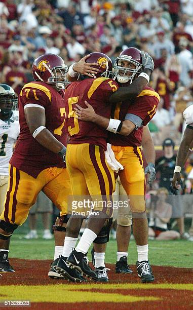 Tail back Reggie Bush and quarterback Matt Leinart of the University of Southern California Trojans celebrate during a NCAA game against the Colorado...