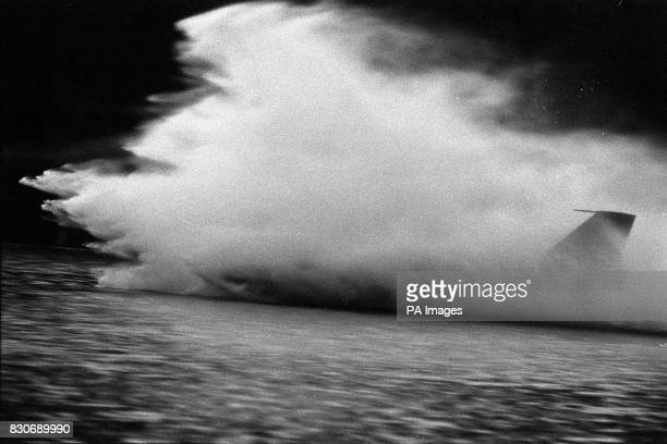 A tail fin is all that's visible of Donald Campbell's Bluebird as a cloud of spray hides the speedboat from view during braking and acceleration...
