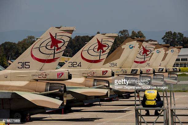 tail fins of israeli air force f-16`s during joint exercise iniohos 2016 in andravida, greece. - flugzeugheck stock-fotos und bilder