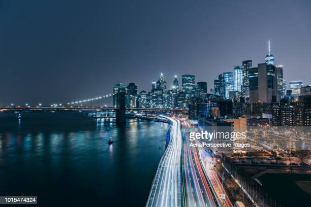 tail light of manhattan downtown at night - lower manhattan stock pictures, royalty-free photos & images