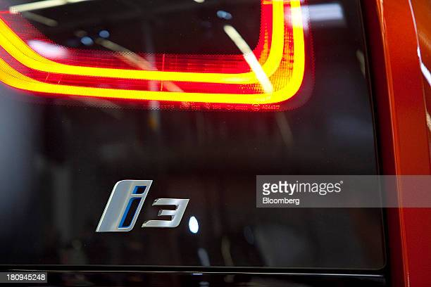 A tail light sits illuminated on a new BMW i3 batterypowered automobile manufactured by Bayerische Motoren Werke AG at the company's factory in...