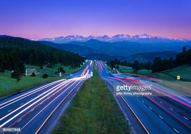 Tail lights at dawn with the Rocky Mountains, Colorado. USA
