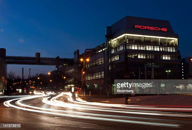 Tail lights from passing traffic are seen at night as they pass the Porsche SE building in Stuttgart Germany on Thursday March 15 2012 Porsche SE the...