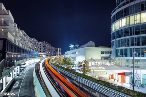 tail lights of subway in vienna residential district - wien österreich stock-fotos und bilder