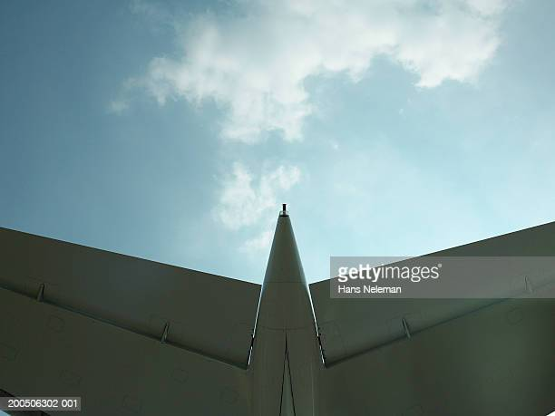 Tail of airplane, low angle view