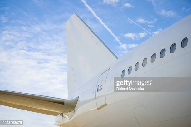 tail of large commercial aircraft - tail stock pictures, royalty-free photos & images