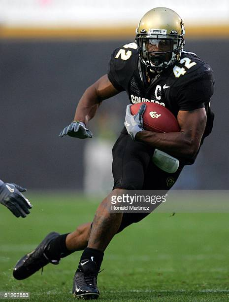 Tailback Bobby Purify of the University of Colorado Buffaloes runs the ball against the Colorado State University Rams on September 4 2004 at Folsom...