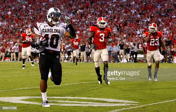 Tailback Brian Maddox of the South Carolina Gamecocks rushes in a touchdown against the Georgia Bulldogs at Sanford Stadium on September 12 2009 in...