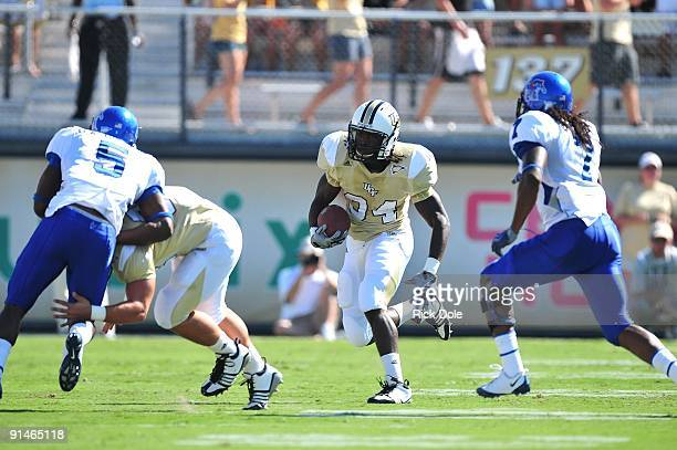 Tailback Brynn Harvey of the Central Florida Knights rushes against the Memphis Tigers at Bright House Networks Stadium on October 3, 2009 in...