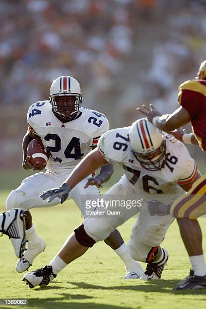 Tailback Carnell Williams of the Auburn Tigers runs with the ball as teammate right guard Ryan Hockett throws a block against the USC Trojans during...