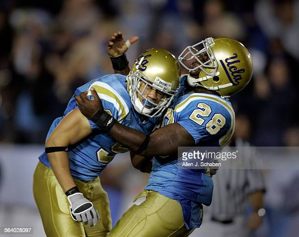 UCLA tailback Chris Markey right celebrates wide receiver Marcus Everett's third quarter touchdown helping UCLA pull–ahead19–7 at the Rose Bowl...