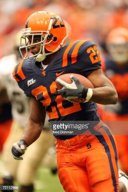 Tailback Curtis Brinkley of the Syracuse University Orange runs with the ball against the University of Pittsburgh Panthers at the Carrier Dome on...