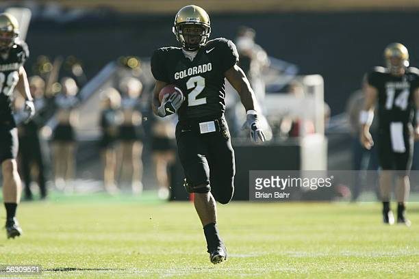 Tailback Hugh Charles of the Colorado Buffaloes carries the ball against the Nebraska Cornhuskers on November 25 2005 at Folsom Field in Boulder...