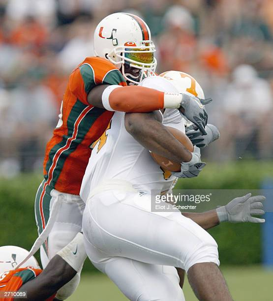 Tailback Jabari Davis of the University of Tennessee Volunteers is tackled by Defensive back Maurice Sikes of the University of Miami Hurricanes...