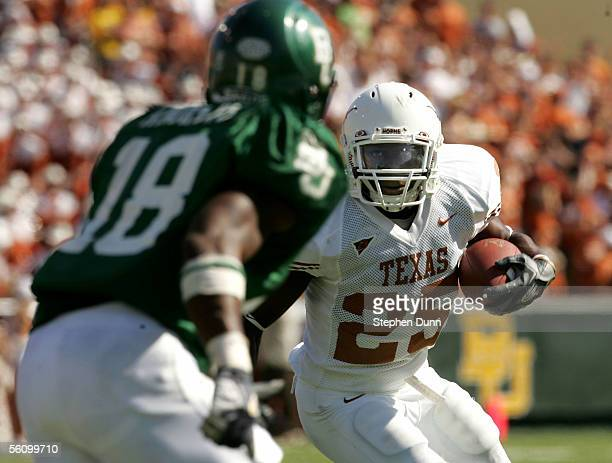 Tailback Jamaal Charles of the Texas Longhorns runs for a touchdown in the second quarter as safety Willie Andrews of the Baylor Bears defends on...