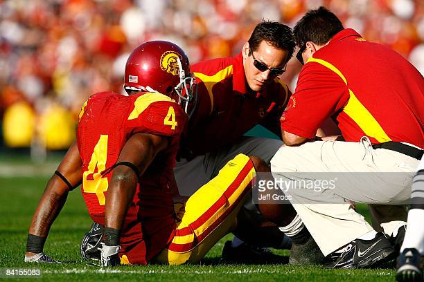 Tailback Joe McKnight of the USC Trojans is attended to by trainers after getting injured in the first half against the Penn State Nittany Lions...