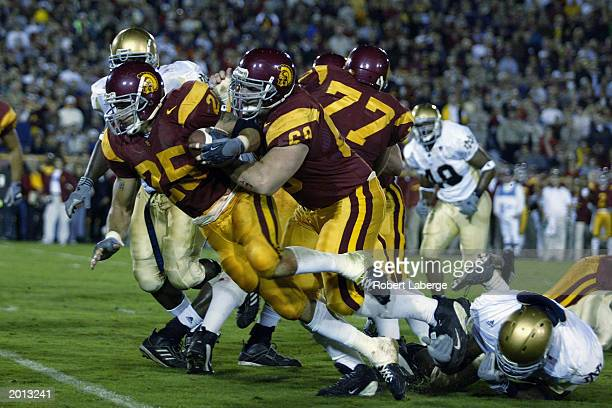 Tailback Justin Fargas of the University of Southern California Trojans carries the ball against the University of Notre Dame Fighting Irish during...