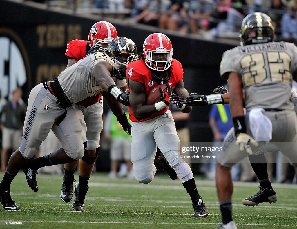 Tailback Keith Marshall #4 of the Georgia Bulldogs rushes against the Vanderbilt Commodores during the second half at Vanderbilt Stadium on September 12, 2015 in Nashville, Tennessee.