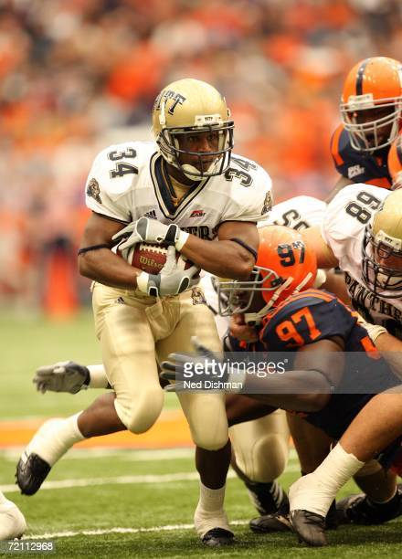Tailback Larod Stephens-Howling of the Pittsburgh Panthers runs against nose tackle Arthur Jones of the Syracuse University Orange at the Carrier...