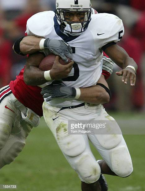 Tailback Larry Johnson of Penn State is tackled and stripped of the ball by Linebacker Matt Wilhelm of Ohio State on October 26 2002 at Ohio Stadium...
