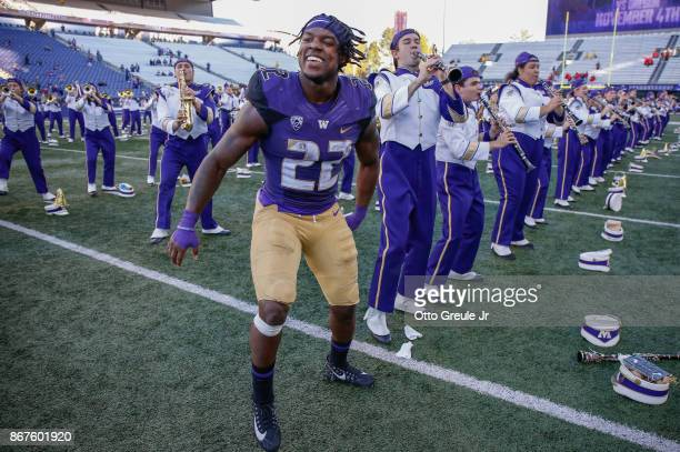 Tailback Lavon Coleman of the Washington Huskies celebrates with members of the marching band after the game against the UCLA Bruins at Husky Stadium...
