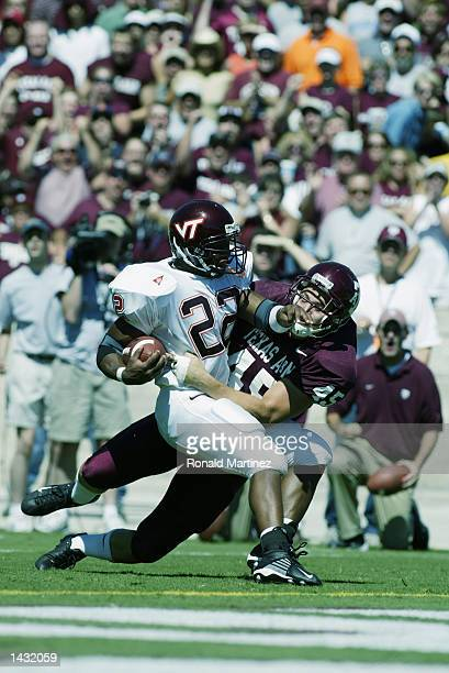 Tailback Lee Suggs of the Virginia Tech Hokies is tackled by Jared Morris of the Texas AM Aggies in the first quarter on September 21 2002 at Kyle...