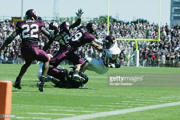 Tailback Lee Suggs of the Virginia Tech Hokies is tackled by Jaxson Appel of the Texas AM Aggies on September 21 2002 at Kyle Field in College...