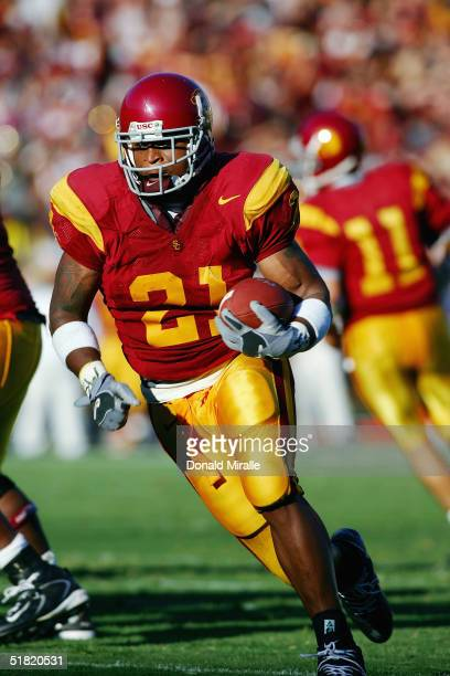Tailback LenDale White of the USC Trojans carries the ball during the game with the Colorado State Rams on September 11 2004 at the Coliseum in Los...
