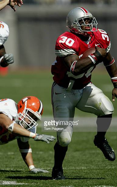 Tailback Lydell Ross of the Ohio State University Buckeyes breaks through the line of scrimmage to score a touchdown against the Bowling Green State...