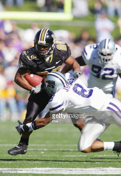 Tailback Marcus Woods of the University of Missouri Tigers is tackled by defensive back Bret Jones of the Kansas State University Wildcats on...