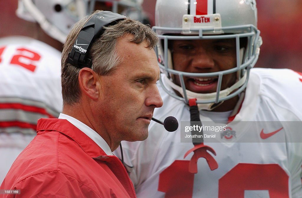 Tailback Maurice Clarett #13 of Ohio State talks with head coach Jim Tressel on the sideline during the NCAA football game against Wisconsin at Camp Randall Stadium in Madison, Wisconsin on October 19, 2002. The Ohio State Buckeyes defeated the Wisconsin Badgers 14 - 19.