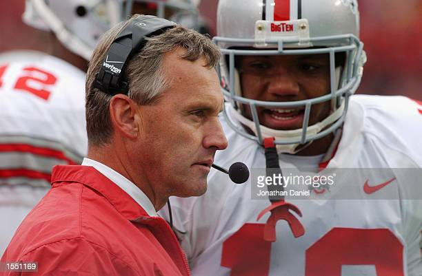 Tailback Maurice Clarett of Ohio State talks with head coach Jim Tressel on the sideline during the NCAA football game against Wisconsin at Camp...