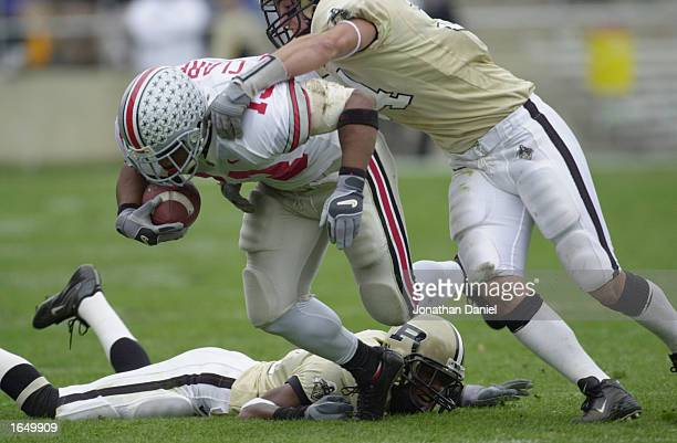 Tailback Maurice Clarett of the Ohio State Buckeyes battles for extra yardage during the Big 10 Conference football game against the Purdue...