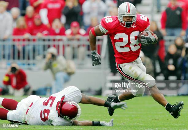 Tailback Maurice Hall of the Ohio State University Buckeyes runs the ball past Cleo Harbison of the Indiana University Hoosiers on October 23, 2004...