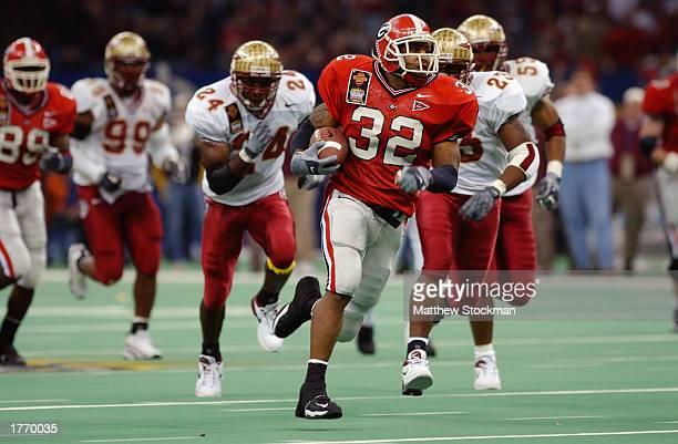 Tailback Musa Smith of the University of Georgia Bulldogs breaks through the Florida State University Seminoles defense during the Nokia Sugar Bowl...