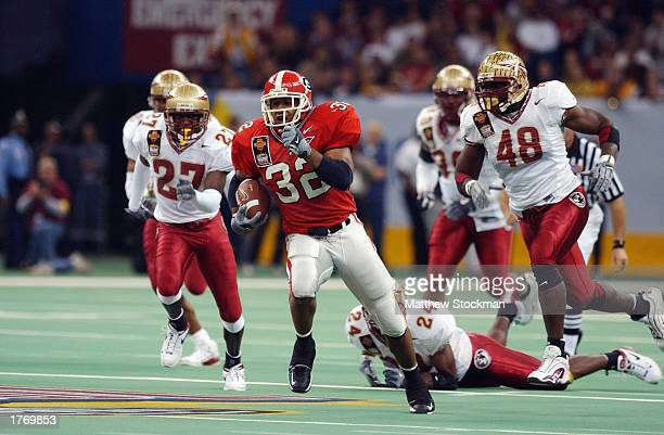 Tailback Musa Smith of the University of Georgia Bulldogs carries the ball during the Nokia Sugar Bowl game against the Florida State University...