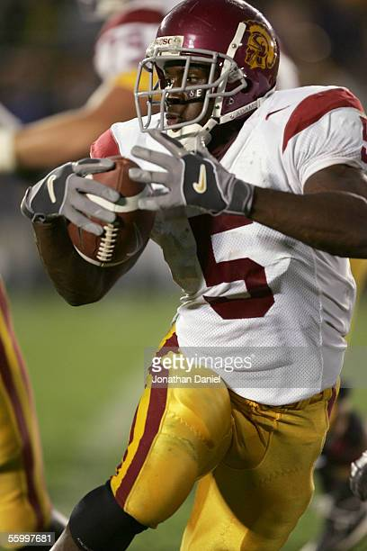 Tailback Reggie Bush of the University of Southern California Trojans carries the ball against the University of Notre Dame Fighting Irish on October...