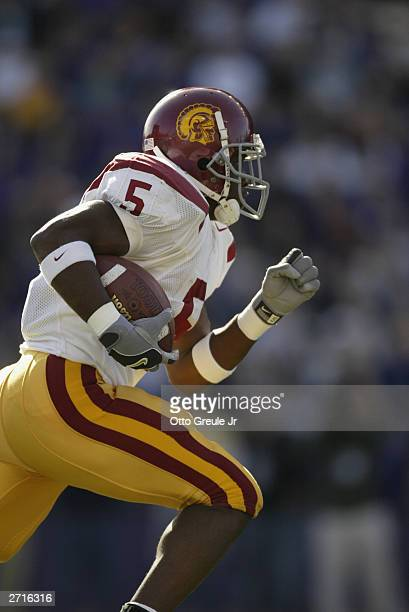 Tailback Reggie Bush of the USC Trojans runs against the Washington Huskies on October 25 2003 at Husky Stadium in Seattle Washington The Trojans won...