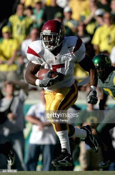Tailback Reggie Bush of the USC Trojans runs with the ball against the Oregon Ducks on September 24 2005 at Autzen Stadium in Eugene Oregon USC...