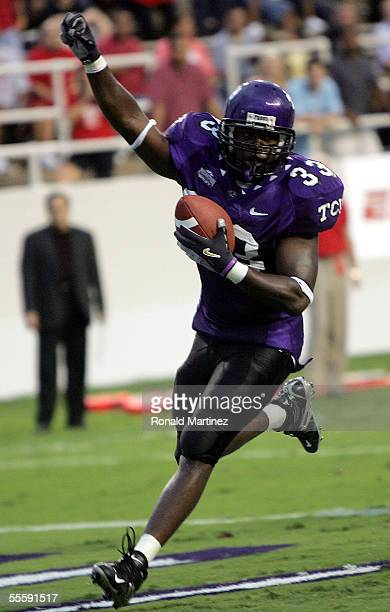 Tailback Robert Merrill of the Texas Christian University Horned Frogs runs for a touchdown against the Utah Utes on September 15, 2005 at Amon...
