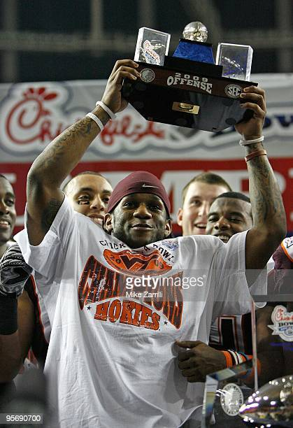 Tailback Ryan Williams of the Virginia Tech Hokies raises the Most Outstanding Offensive Player trophy after the ChickfilA Bowl against the Tennessee...