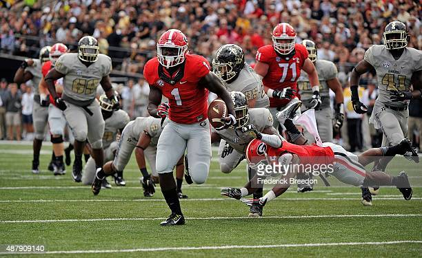 Tailback Sony Michel of the Georgia Bulldogs rushes for a touchdown against the Vanderbilt Commodores during the first half at Vanderbilt Stadium on...