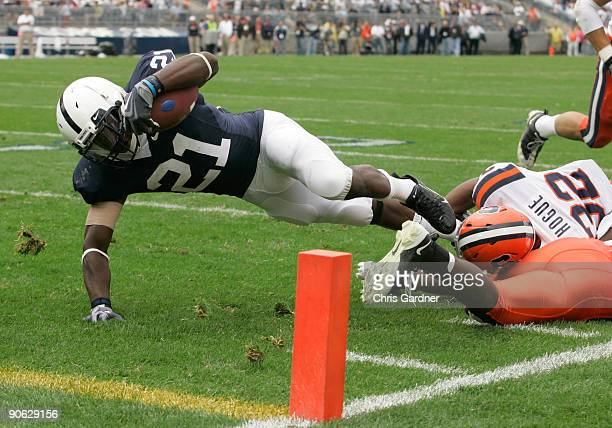 Tailback Stefon Green of the Penn State Nittany Lions is tackled short of the goal line by linebacker Doug Hogue of the Syracuse Orangemen during the...