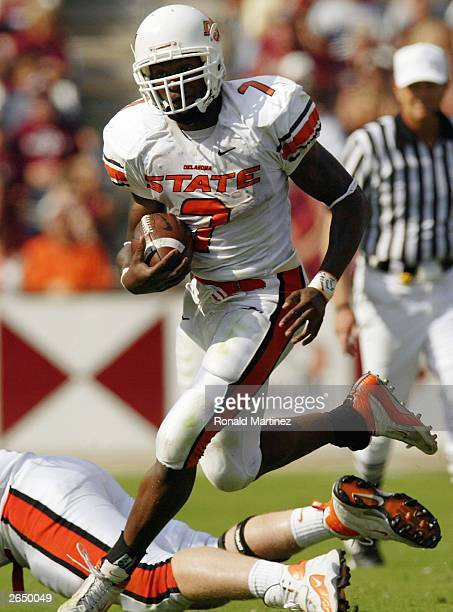 Tailback Tatum Bell of the Oklahoma State Cowboys runs for a 40-yard touchdown on fourth and one against the Texas A&M Aggies at Kyle Field on...