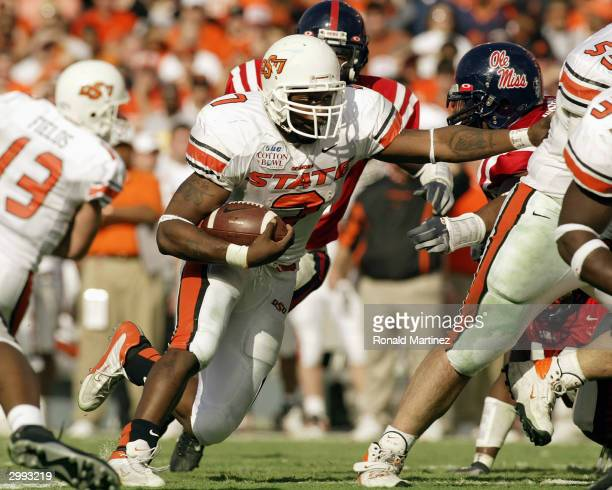Tailback Tatum Bell of the Oklahoma State Cowboys runs the ball against the Mississippi Rebels during the SBC Cotton Bowl on January 2 2004 at the...