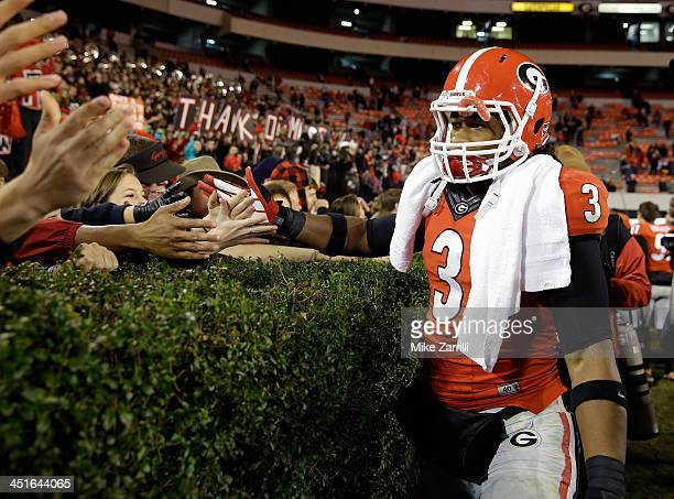 Tailback Todd Gurley of the Georgia Bulldogs high fives fans near the hedges after the game against the Kentucky Wildcats at Sanford Stadium on...