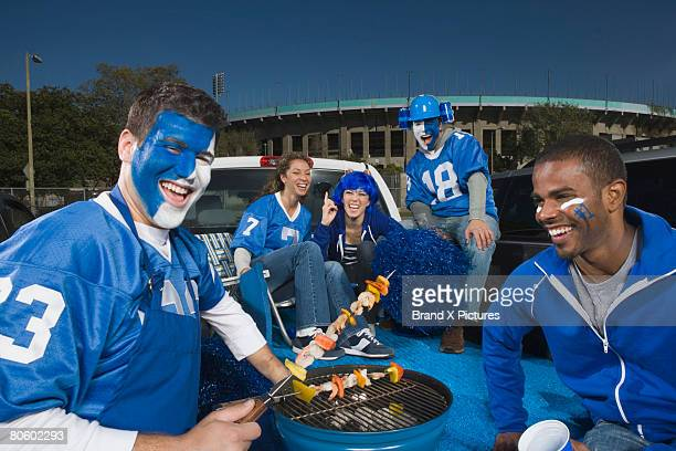 tailgating fans grilling kebabs - tailgate party stock pictures, royalty-free photos & images